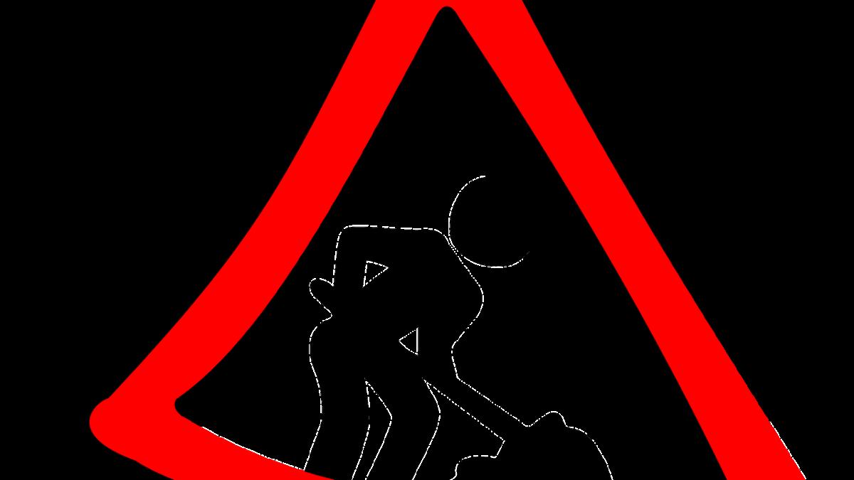 Grafika. Znak: prace drogowe